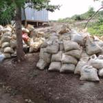 Sacks of sand and gravel for hand mixing the concrete for the resort