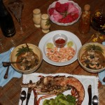 Multi-course meal with fresh grilled lobster